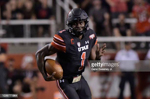 Quarterback Tyler Huntley of the Utah Utes runs with the ball in a game against the Washington Huskies at RiceEccles Stadium on September 15 2018 in...