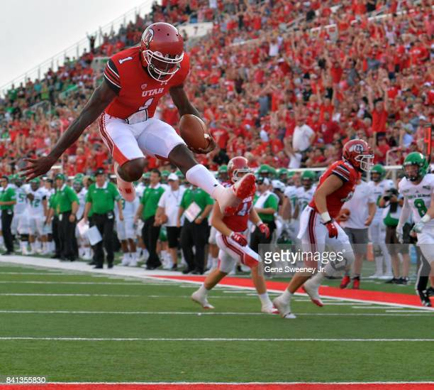 Quarterback Tyler Huntley of the Utah Utes scores a first half touchdown against the North Dakota Fighting Hawks at RiceEccles Stadium on August 31...