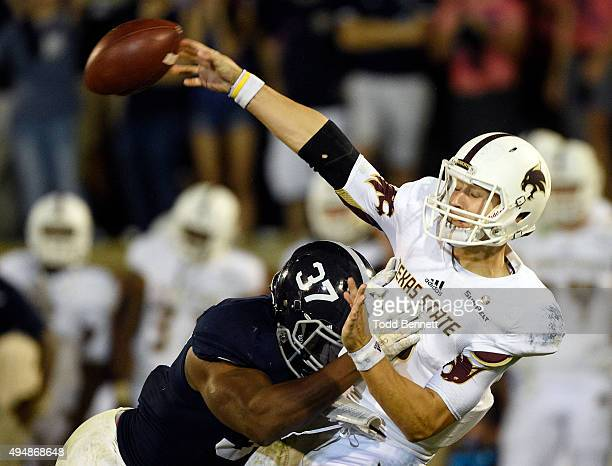 Quarterback Tyler Jones of the Texas State Bobcats is hit by linebacker Antwione Williams of the Georgia Southern Eagles during the fourth quarter on...