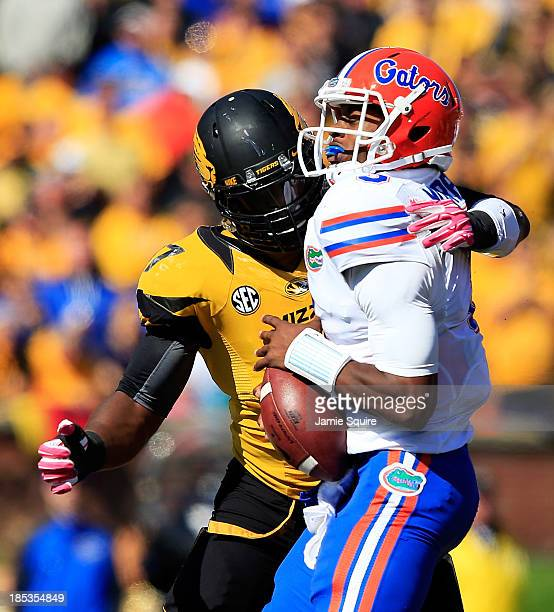 Quarterback Tyler Murphy of the Florida Gators is hit by defensive lineman Kony Ealy of the Missouri Tigers during the game at Faurot Field/Memorial...