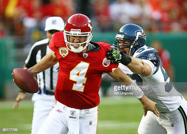 Quarterback Tyler Thigpen of the Kansas City Chiefs is tackled by defensive end Patrick Kerney of the Seattle Seahawks in a game at Arrowhead Stadium...