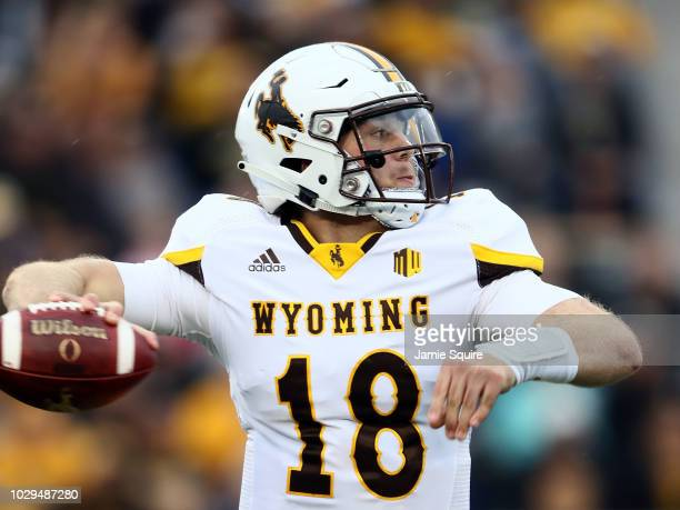 Quarterback Tyler Vander Waal of the Wyoming Cowboys passes during the game against the Missouri Tigers at Faurot Field/Memorial Stadium on September...