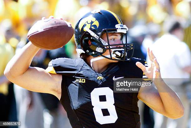 Quarterback Tyler Wiegers of the Iowa Hawkeyes throws passes before the matchup against the Ball State Cardinals on September 6 2014 at Kinnick...