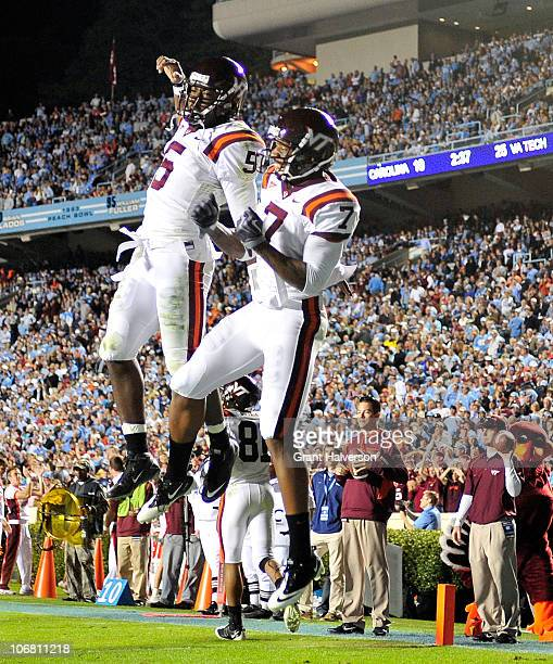 Quarterback Tyrod Taylor and Marcus Davis of the Virginia Tech Hokies celebrate after connecting for a touchdown against the North Carolina Tar Heels...