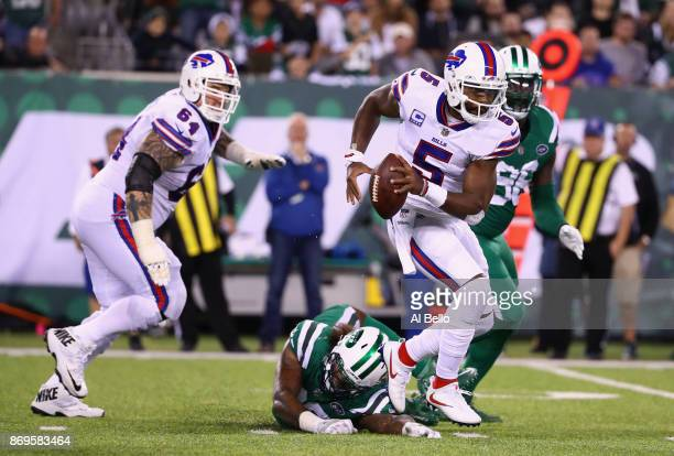 Quarterback Tyrod Taylor of the Buffalo Bills avoids a sack by defensive end Leonard Williams of the New York Jets during the third quarter of the...