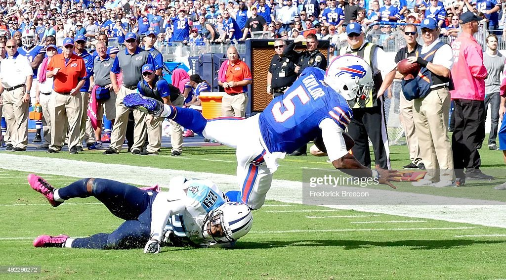 Quarterback Tyrod Taylor #5 of the Buffalo Bills dives for additional yardage against Perrish Cox #29 of the Tennessee Titans during the second half of a game at Nissan Stadium on October 11, 2015 in Nashville, Tennessee.