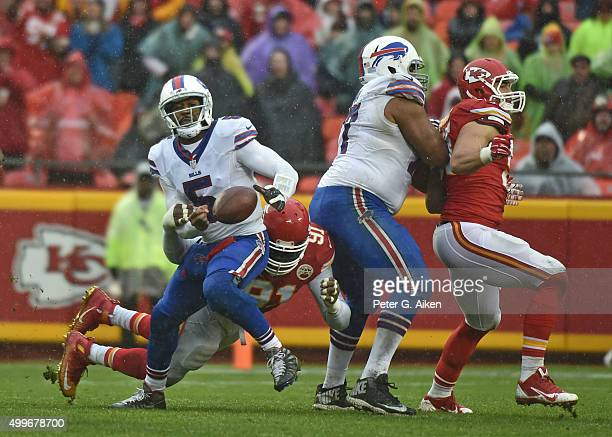 Quarterback Tyrod Taylor of the Buffalo Bills fumbles the ball after getting hit from behind from linebacker Tamba Hali of the Kansas City Chiefs...