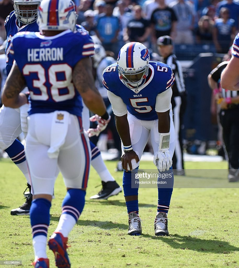Quarterback Tyrod Taylor #5 of the Buffalo Bills grimaces after receiving a late hit by the Tennessee Titans during the second half of a game at Nissan Stadium on October 11, 2015 in Nashville, Tennessee.