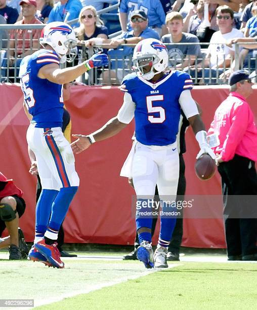 Quarterback Tyrod Taylor of the Buffalo Bills is congratulated by teammate Chris Hogan after scoring a touchdown against the Tennessee Titans during...
