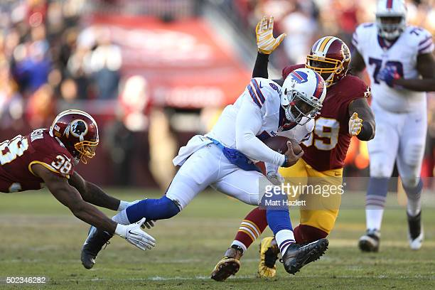 Quarterback Tyrod Taylor of the Buffalo Bills is tackled by free safety Dashon Goldson and defensive tackle Ricky Jean Francois of the Washington...