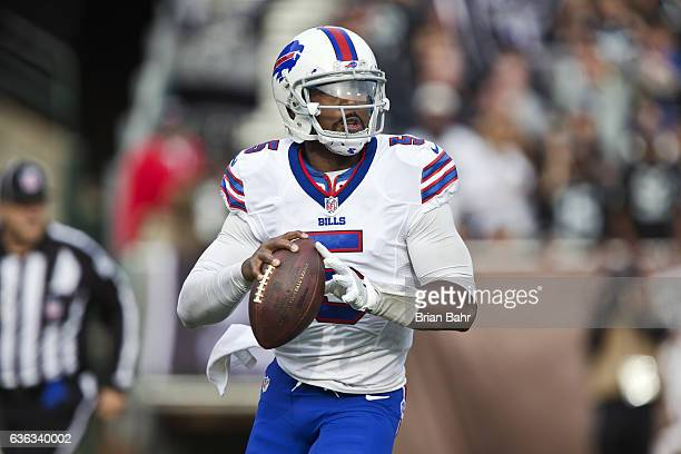 Quarterback Tyrod Taylor of the Buffalo Bills looks for a receiver against the Oakland Raiders in the second quarter on December 4 2016 at...