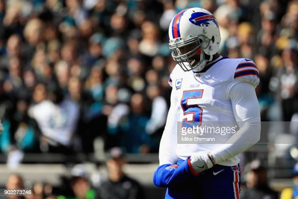 Quarterback Tyrod Taylor of the Buffalo Bills looks on in the first quarter against the Jacksonville Jaguars during the AFC Wild Card Playoff game at...