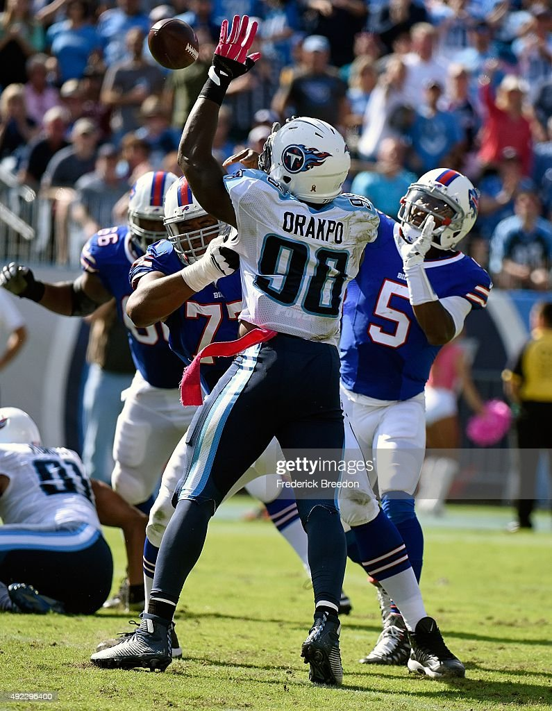Quarterback Tyrod Taylor #5 of the Buffalo Bills passes the ball over Brian Orakpo #98 of the Tennessee Titans during the second half of a game at Nissan Stadium on October 11, 2015 in Nashville, Tennessee.