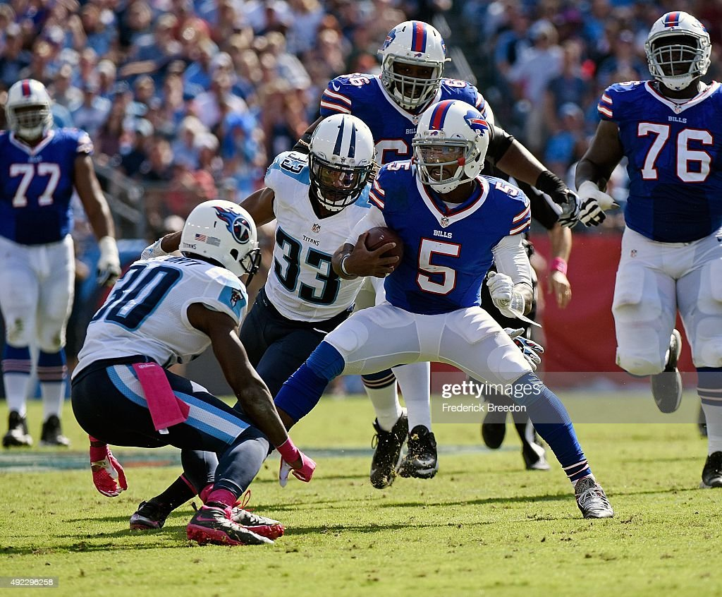 Quarterback Tyrod Taylor #5 of the Buffalo Bills rushes against Jason McCourty #30 of the Tennessee Titans during the second half of a game at Nissan Stadium on October 11, 2015 in Nashville, Tennessee.