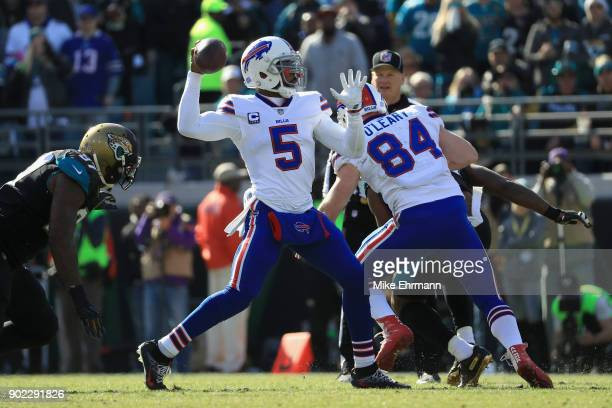 Quarterback Tyrod Taylor of the Buffalo Bills throws a second quarter pass against the Jacksonville Jaguars during the AFC Wild Card Playoff game at...