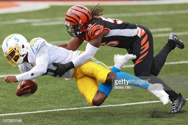 Quarterback Tyrod Taylor of the Los Angeles Chargers is tackled by middle linebacker Josh Bynes of the Cincinnati Bengals during the second half at...