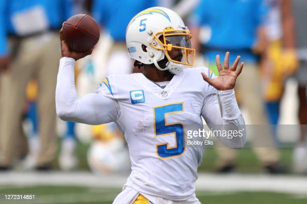 Quarterback Tyrod Taylor of the Los Angeles Chargers looks to pass against the Cincinnati Bengals during the first half at Paul Brown Stadium on...
