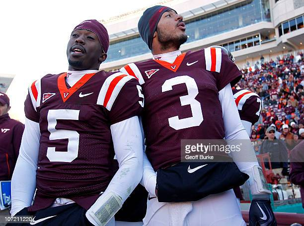 Quarterback Tyrod Taylor of the Virginia Tech Hokies and quarterback Logan Thomas of the Virginia Tech Hokies stand on the sidelines against the...