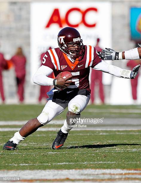 Quarterback Tyrod Taylor of the Virginia Tech Hokies runs with the ball against the Virginia Cavaliers at Lane Stadium on November 27 2010 in...