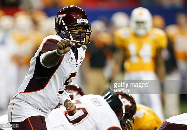 Quarterback Tyrod Taylor of the Virginia Tech Hokies signals to the offense during the ChickFilA Bowl against the Tennessee Volunteers at the Georgia...