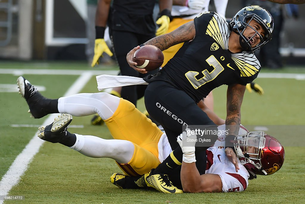 Quarterback Vernon Adams Jr. #3 of the Oregon Ducks injures his ankle as he is tackled by linebacker Anthony Sarao #56 of the USC Trojans during the third quarter of the game at Autzen Stadium on November 21, 2015 in Eugene, Oregon. The Ducks won the game 48-28.