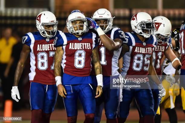 Quarterback Vernon Adams Jr #8 of the Montreal Alouettes celebrates his touchdown in the fourth quarter with teammates against the Hamilton TigerCats...