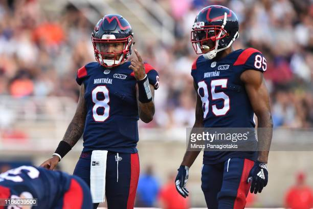 Quarterback Vernon Adams Jr. #8 of the Montreal Alouettes gives out instructions to teammate and wide receiver B.J. Cunningham against the Ottawa...