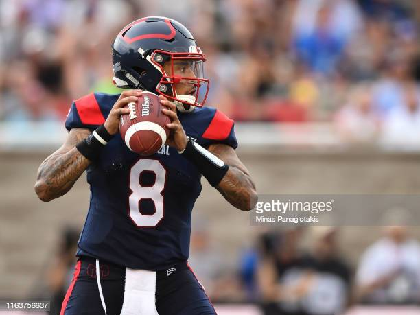 Quarterback Vernon Adams Jr. #8 of the Montreal Alouettes looks to pass the ball against the Edmonton Eskimos during the CFL game at Percival Molson...