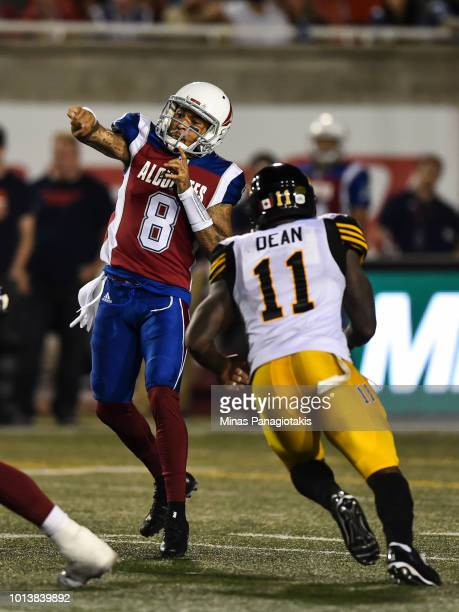 Quarterback Vernon Adams Jr #8 of the Montreal Alouettes plays the ball against the Hamilton TigerCats during the CFL game at Percival Molson Stadium...