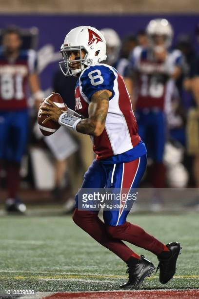 Quarterback Vernon Adams Jr #8 of the Montreal Alouettes prepares to play the ball against the Hamilton TigerCats during the CFL game at Percival...