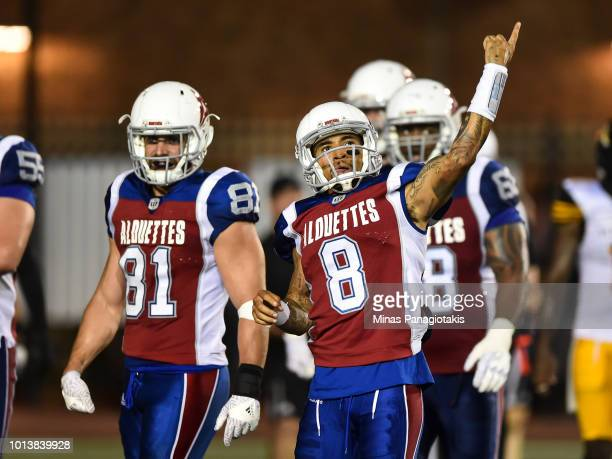 Quarterback Vernon Adams Jr #8 of the Montreal Alouettes reacts after scoring a touchdown in the fourth quarter against the Hamilton TigerCats during...
