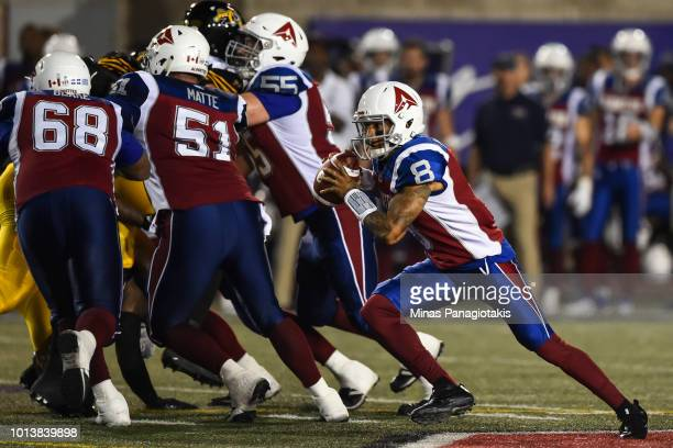 Quarterback Vernon Adams Jr #8 of the Montreal Alouettes runs with the ball against the Hamilton TigerCats during the CFL game at Percival Molson...