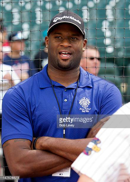 Quarterback Vince Young of the Philadephia Eagles talks with fans before the game between the Colorado Rockies and the Houston Astros on Opening Day...