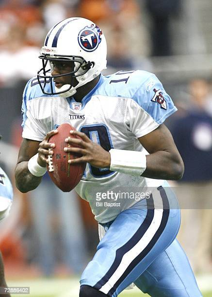Quarterback Vince Young of the Tennessee Titans attempts to throw the ball during the game against the Houston Texans at Reliant Stadium on December...