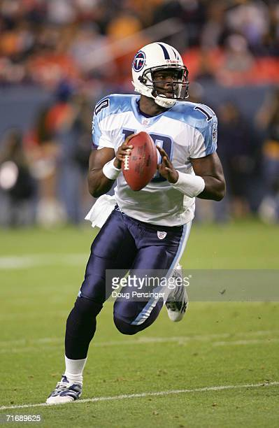 Quarterback Vince Young of the Tennessee Titans looks for a receiver against the Denver Broncos during preseason NFL action on August 19 2006 at Mile...