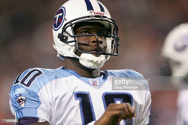 Quarterback Vince Young of the Tennessee Titans looks on against the Denver Broncos during preseason NFL action on August 19 2006 at Mile High...