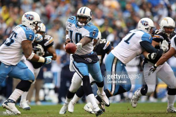 Quarterback Vince Young of the Tennessee Titans looks to hand off the ball to LenDale White in the first quarter during their AFC Wild Card Playoff...