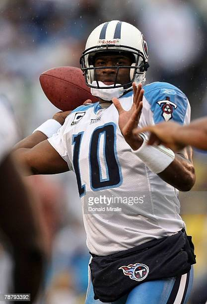 Quarterback Vince Young of the Tennessee Titans looks to make a pass play during their AFC Wild Card Playoff Game against the San Diego Chargers at...