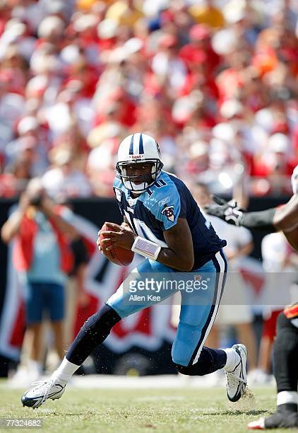 Quarterback Vince Young of the Tennessee Titans scrambles during the game against the Tampa Bay Buccaneers at Raymond James Stadium on October 14,...