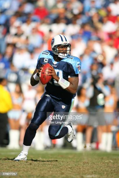 Quarterback Vince Young of the Tennessee Titans scrambles in a game against the Carolina Panthers at LP Field on November 4, 2007 in Nashville,...