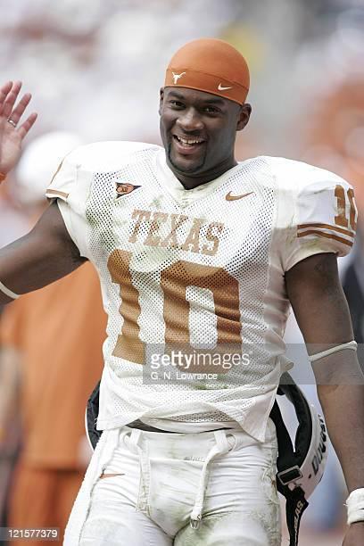 Quarterback Vince Young of the Texas Longhorns celebrates on the sidelines against the Colorado Buffalos in the Big 12 Championship at Reliant...