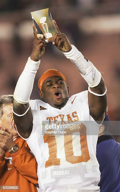 Quarterback Vince Young of the Texas Longhorns celebrates victory with the MVP trophy after defeating the Michigan Wolverines in the 91st Rose Bowl...