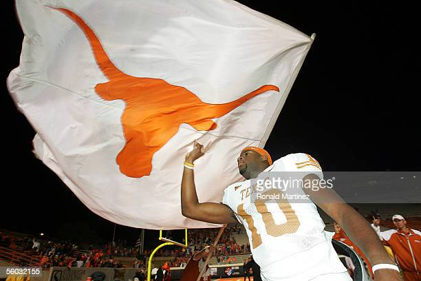 Quarterback Vince Young of the Texas Longhorns celebrates victory against the Oklahoma State Cowboys October 29, 2005 at Boone Pickens Stadium in...