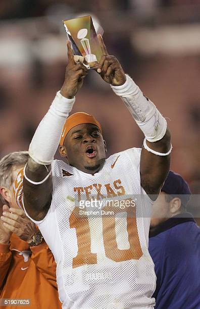 Quarterback Vince Young of the Texas Longhorns celebrates with the MVP trophy after a victory over the Michigan Wolverines in the 91st Rose Bowl Game...