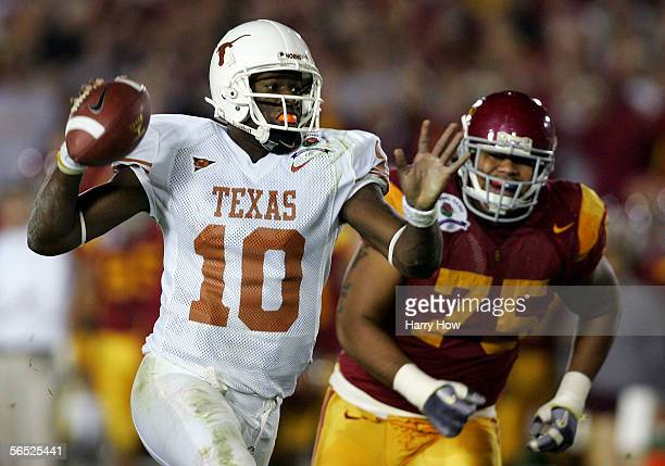 Quarterback Vince Young of the Texas Longhorns fakes a pass as he is run down by Fili Moala of the USC Trojans and runs in for a touchdown during the...