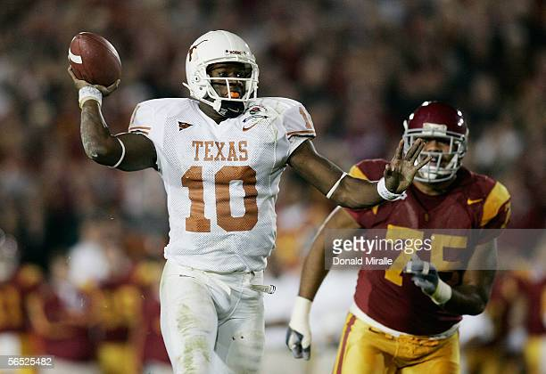 Quarterback Vince Young of the Texas Longhorns fakes a pass before scoring on a 17yard touchdown run against the USC Trojans in the fourth quarter...