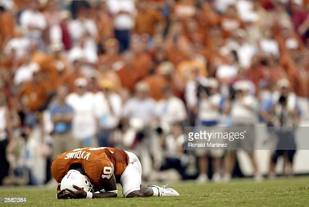 Quarterback Vince Young of the Texas Longhorns falls on the ground after losing the ball on a fourth down attempt against the Oklahoma Sooners at the...