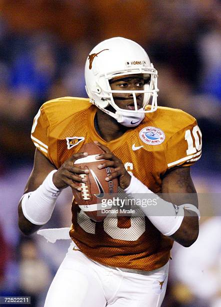 Quarterback Vince Young of the Texas Longhorns looks to throw against the Washington State Cougars in firsthalf action during the Holiday Bowl...
