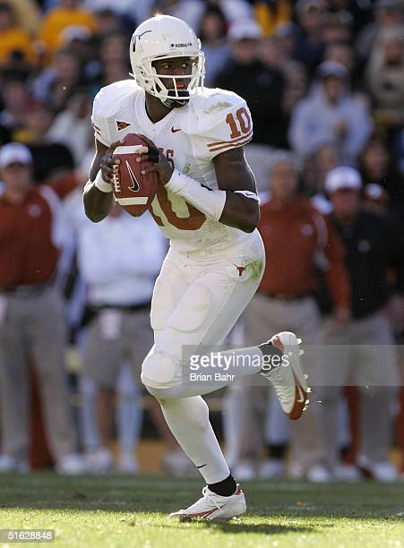 Quarterback Vince Young of the Texas Longhorns rolls out against the Colorado Buffaloes in the third quarter on October 30 2004 at Folsom Field in...