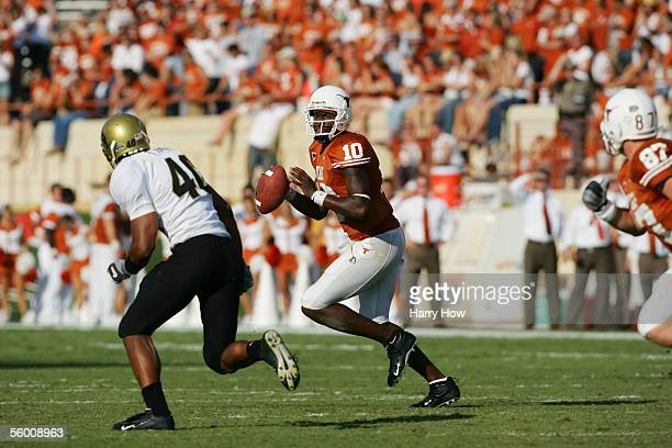 Quarterback Vince Young of the Texas Longhorns rolls out against the Colorado Buffaloes at Darrell K RoyalTexas Memorial Stadium on October 15 2005...
